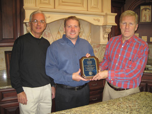 Tom Cross, Right, Presents October 2010 Ovation To Business Award To Brakur  Custom Cabinetryu0027s General Manager Joe Sprietzer And President Chad Kurtz.