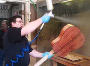 Richelieu's finishing seminar taught industrial technology students to apply a polyester finish to wood guitars.